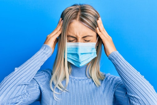 People have reported complain of headaches, discomfort, dehydration, and disorientation after wearing the mask for long (Image: Shutterstock)