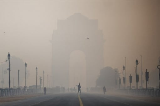 A soldier walks along a street near India Gate amid smoggy conditions in New Delhi. (AFP)