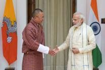 Day in Photos - July 6: PM Modi Meets Bhutan PM Tobgay; Assam Floods; Amaranth Yatra