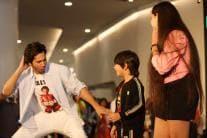 PHOTOS  Varun Dhawan Enthralls Fans at EmQuartier Mall in Bangkok