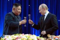 Pictures From Vladimir Putin & Kim Jong-un's First-Ever Summit
