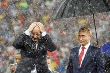 Vladimir Putin's Umbrella Act Steals the Show at FIFA World Cup Presentation