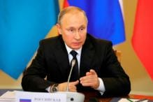 'Don't Worry, be Happy', Says Putin After Trump Ditches Paris Climate Accord