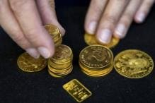 Gold Holds Steady Amid Firm Dollar, Stronger Equities