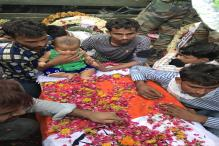 Kashmir Martyr's Infant Child Sits on His Coffin, Making Everyone Emotional