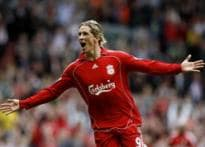 Liverpool hit Derby for six to go top