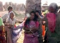 Villagers catch 'witch', beat up and parade her