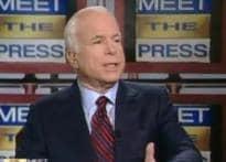 McCain hits back, says he is not like President Bush