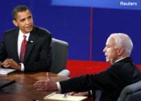 McCain takes on Obama, questions his character