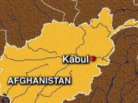 Afghan woman candidate packs gun, wears trousers