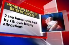 Two bureaucrats arrested on bribery charges