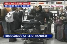 Passengers crowd airport for tickets
