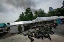Riots erupt after Thai protest leaders surrender