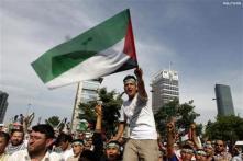 Turks mourn dead as Israel offers probe