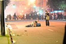Kiss in time of riots: Mystery couple in lip lock as Vancouver burns