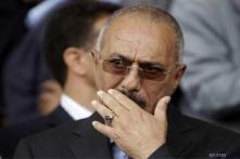 Yemen's Saleh leaves for US, opponents protest