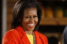 Michelle Obama wins push-up challenge on TV
