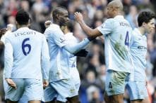 Man City stay ahead with 2-0 win over Bolton
