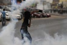Bahrain GP to go ahead as protests flare