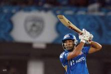Nerveless Rohit steers MI to last-ball win