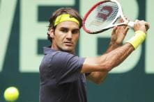 Federer to meet Haas in Halle final