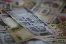 Rupee hits an all-time low of 57.12 against US dollar