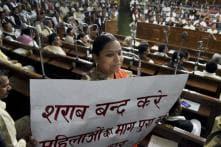 Bihar: MLA protests against govt policies with liquor bottles