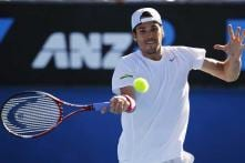 Haas progresses in Florida, Nishikori retires injured