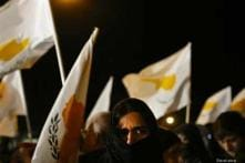 Cyprus closes in on EU bailout, U-turn on levy