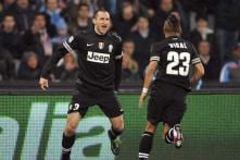 Juventus have title in sight after 1-1 draw with Napoli
