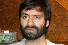 Yasin Malik returns to India, faces protests