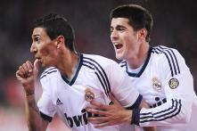 Real make Barcelona wait for La Liga title by beating Atletico 2-1