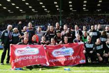 Cardiff follow EPL promotion with Championship title