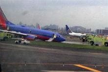 10 hurt as flight's landing gear collapses while touching runway at LaGuardia Airport