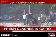 Egypt crisis: Protesters defy curfew, fresh clashes erupt in Cairo