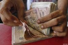Rupee trims losses vs dollar, still down by 25 paise