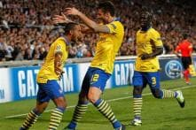 In-form Arsenal face Napoli test in Champions League