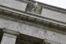 US Federal Reserve surprises, sticks to bond-buying stimulus as it cuts growth outlook