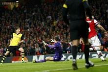 Dortmund win at Arsenal with late Lewandowski goal