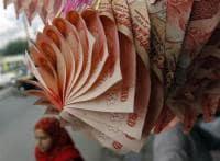 Rupee at two-week high, closes at 62.36 per US dollar