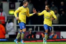 Theo Walcott's double gives Arsenal 3-1 win at West Ham
