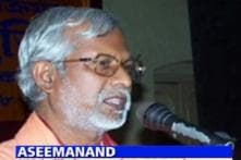 Saffron outfit protests against Aseemanand's interview
