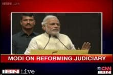 Modi hits out at Centre over lack of infrastructure in legal system