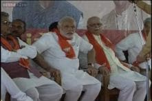 All praise for each other, Modi, Advani vow to lead BJP back to power