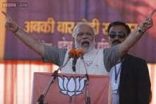 Man and myth collide as Modi eyes final ascent to power
