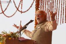 Modi takes on Gandhis in their bastion of Amethi for 'sister' Smriti
