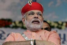Narendra Modi drives through; Benaras comes to stand-still