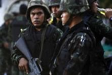Thai military summons former premier, other leaders after coup