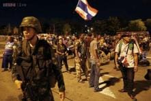 Thai army chief summons ousted PM for talks a day after coup