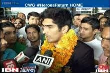 CWG 2014: Indian boxers return home to a rousing welcome